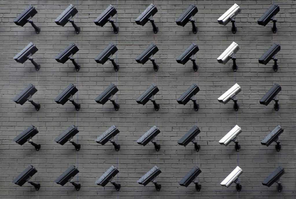 A wall of surveillance cameras.