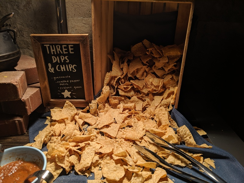 It is important for corn chips to spill out from a wooden crate, apparently.